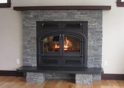 Stone Fireplace Interior by Orca Masonry